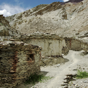 Stupas and mani walls at the approach to Chilling Village