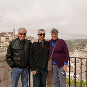 Rob Mari, Steve and Pauline Kenny with the Sassi of Matera in the background