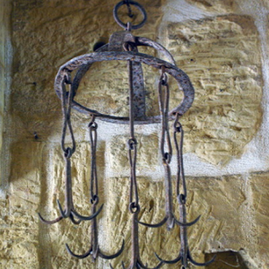 Grappling iron usedl to retrieve a lost bucket, Gharb Folklore Museum