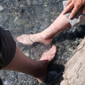 Feet in glacial waters